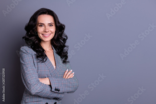 Fototapety, obrazy: Turned photo of beautiful woman crossing her hands looking wearing suit isolated over gray background