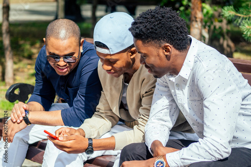 Photo a group of three fashionable well-dressed cool African American guys students co