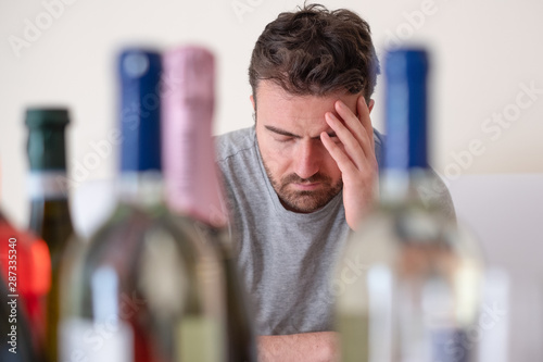 Photo sur Toile Les Textures Depressed man drinking hard liquor at home