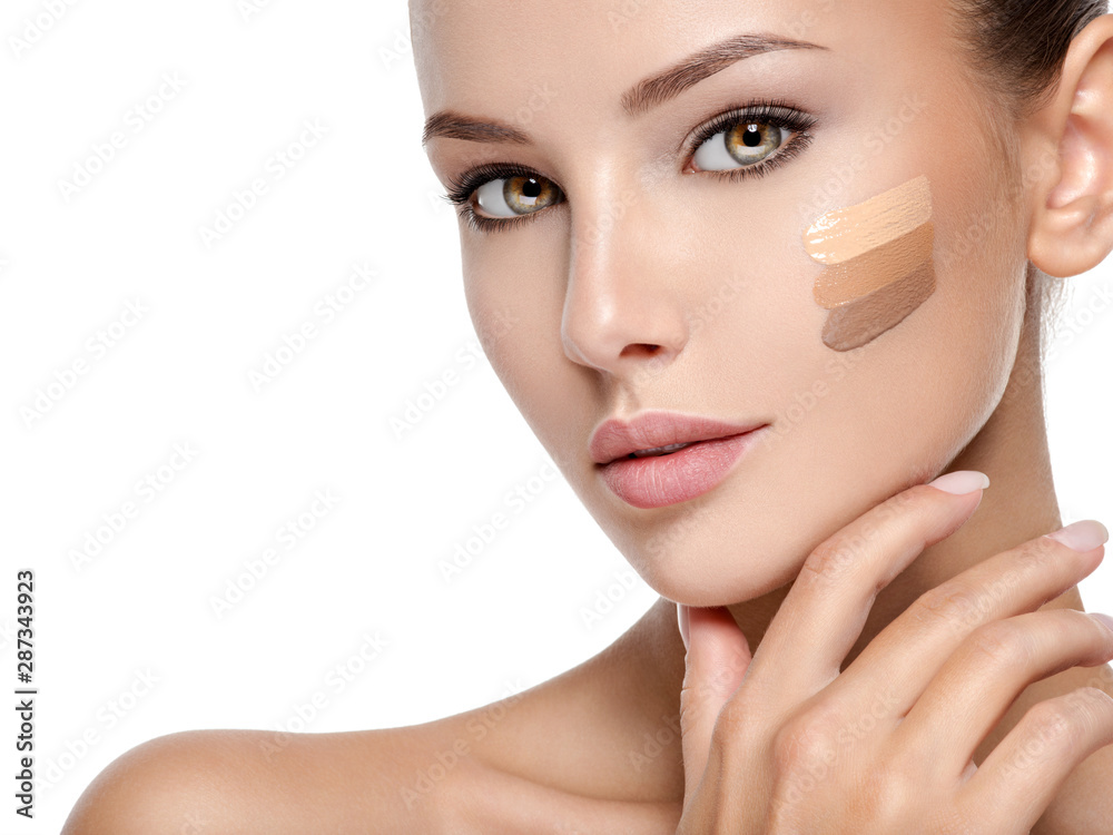 Fototapeta Beautiful face of  woman with cosmetic foundation on a skin.