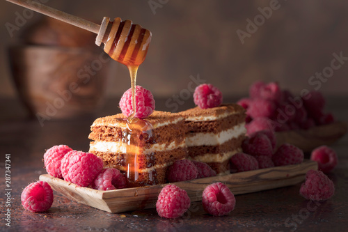 Fototapeta Layered honey cake with raspberries. obraz