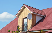 Attic House Roofing Construction With Metal Roof And Metal Balcony