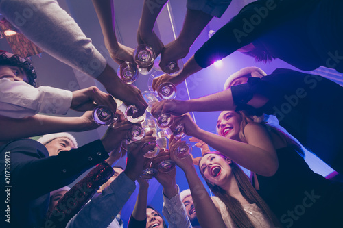 Low below angle view of nice attractive cheerful cheery girls and guys having fu Tapéta, Fotótapéta