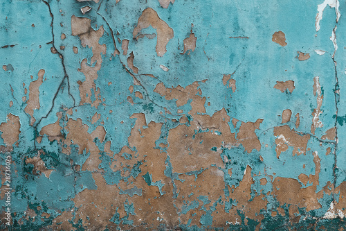 Fototapeta  Old and worn out wall background with paint peeling off , Grunge texture of buil