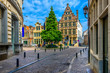 canvas print picture - Old narrow street with tables of cafe in Ghent (Gent), Belgium. Architecture and landmark of Ghent. Cozy cityscape of Ghent.