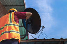 Asian Young Engineers Install Satellite Dishes