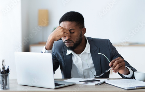 African american businessman tired of long time work on laptop Canvas