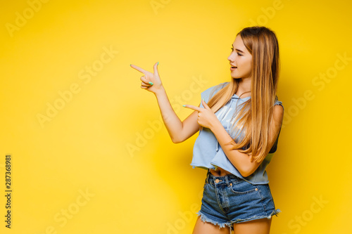 Fototapeta  Young blonde woman over isolated yellow wall have an idea and posing