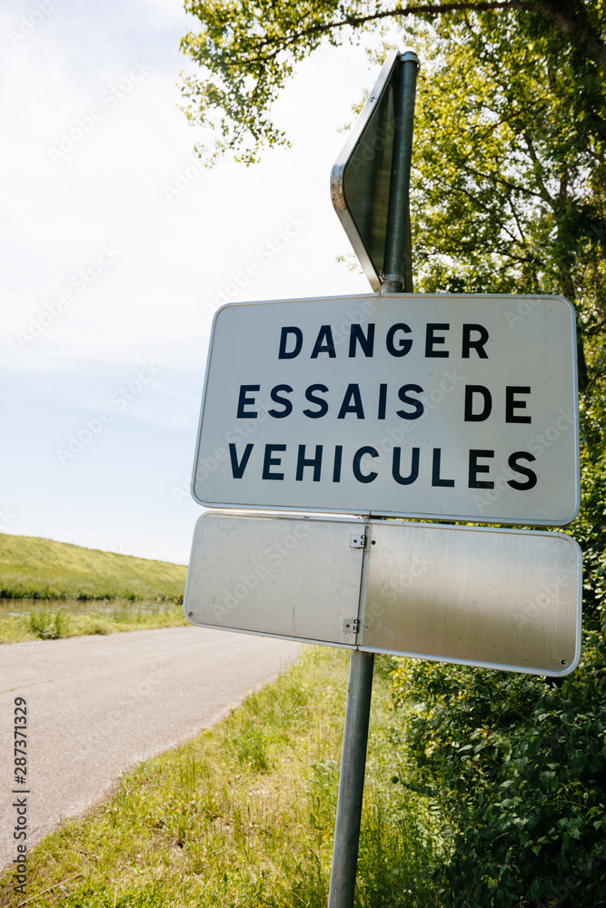 Danger, Essais de vehicules translated freom French as Danger, new vehicles testing near the dedicated for tests highway in France