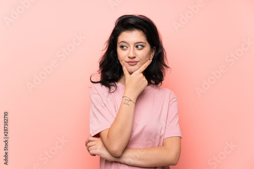 Fototapety, obrazy: Young woman over isolated pink background laughing