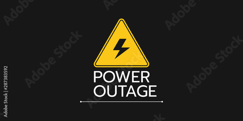 Fotografía  the banner of a power cut with a warning sign the one is on the solid black background