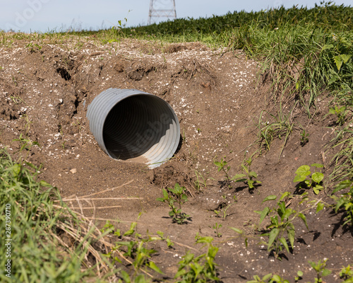 Fényképezés New corrugated metal drainage culvert pipe installed in ditch along road for acc