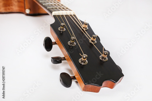 Tuning pegs on wooden machine head of six strings guitar on white background Fototapeta