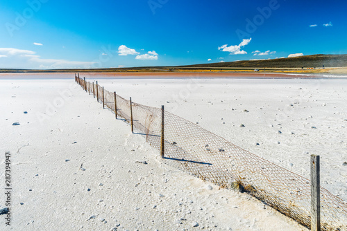 Old fence in a salt lake in Tierra del Fuego in Argentina