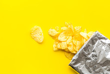 Potato Chips Bag Ready To Eat On Yellow Background Top View Mock Up