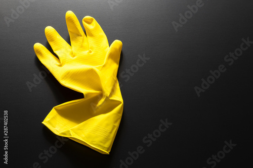 yellow rubber glove isolated on black background Slika na platnu