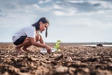 Asian Girl Watering Green Plan...