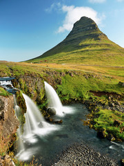 Waterfall in the mountains. Iceland