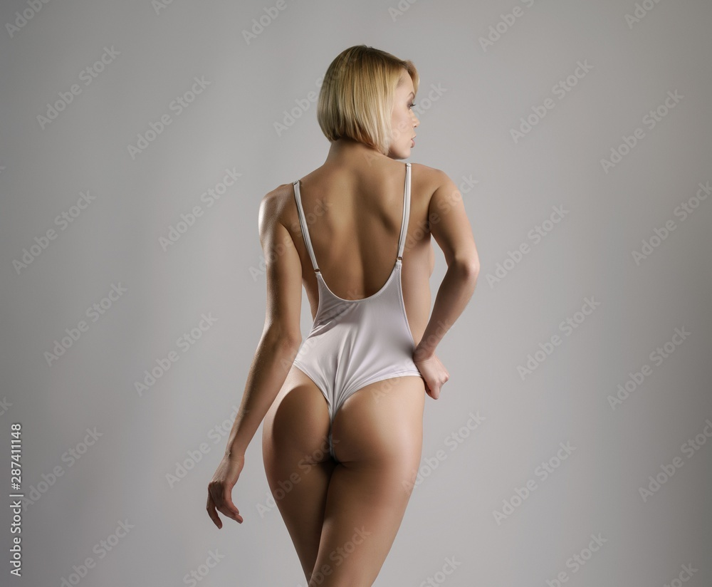 Fototapety, obrazy: Rear view of blonde posing in sexy white bodysuit