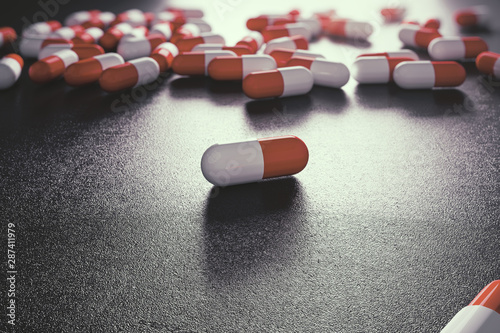 Fotografering  Abstract spilt pills background