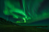 Aurora borealis (Northern Lights) and partially frozen lake, North Snaefellsnes, Iceland