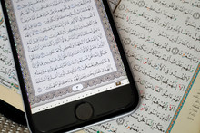 Digital Quran On A Smartphone And Holy Quran Book, Vietnam