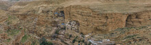 Monastery Of Saints George And John Jacob Of Choziba Is Wadi Qelt, Israel. The Cliff-hanging Complex With Its Ancient Chapel And Gardens, Nhabited By Greek Orthodox Monks. Panorama