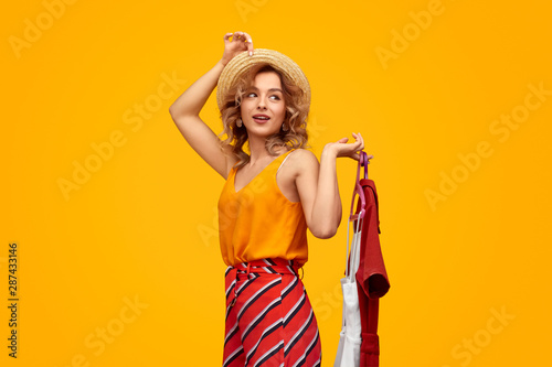 Smiling trendy blonde with trendy clothes