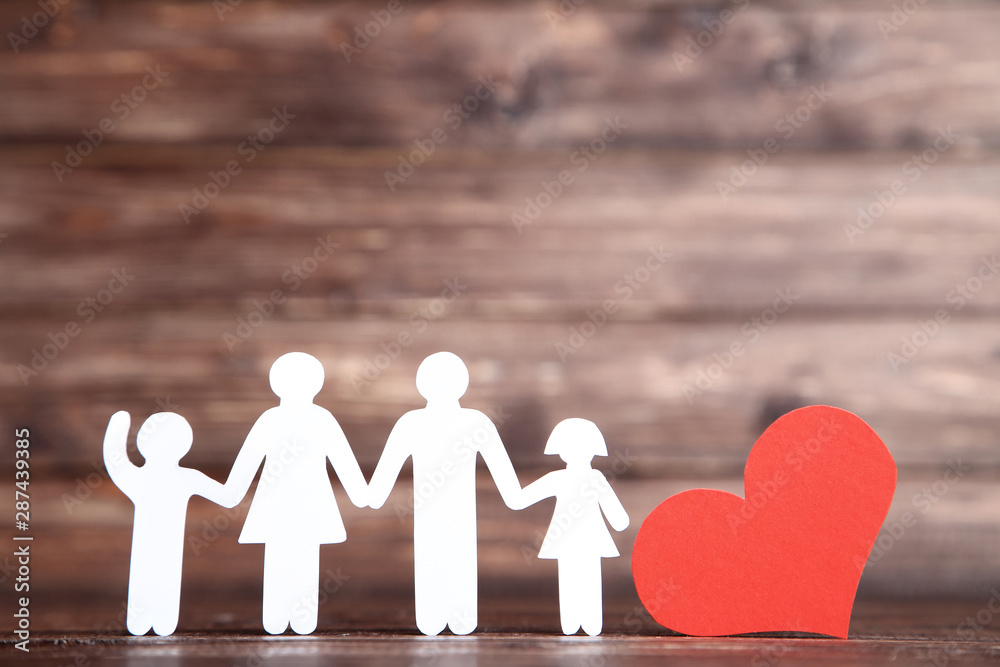Fototapety, obrazy: Family figures with red heart on brown wooden table