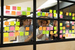 canvas print picture Multiracial business team brainstorm on project write on sticky notes