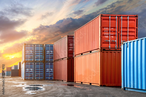 Fotografia Stack of containers box from Cargo freight ship for import-export at harbor and transportation industrial concept