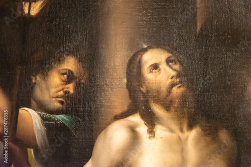 Detail of medieval painting showing aggressor of Jesus Canvas Print