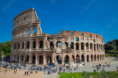 Fényképezés  Tourists visiting the famous Colosseum in Rome in a beautiful early spring day