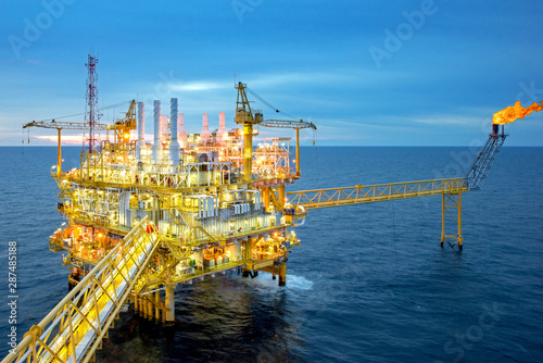 Fototapeta Large Offshore oil rig drilling platform at sunset and beautiful sky in the gulf of Thailand obraz