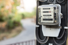 Close Up Of Electric Meters On...