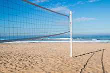 Beach Volleyball Court With An Ocean Background.