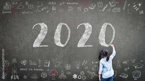 Fototapeta 2020 Happy new year school class academic calendar with student kid's hand drawi