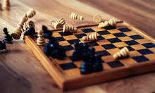 Wooden Chess Pieces Are Lying On A Chessboard. Concept Logic, Strategy, Defeat