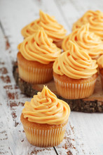 Cupcakes With Orange Icing On Top