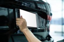 Asian Man Installing The Licence Plate Of A Car. Technician Installing Car Plate. A Car Plate Being Install By Asian Man. Car License Plate Black. Licence Holder Adjusting On Black Vehicle.