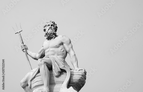The mighty god of the sea and oceans Neptune (Poseidon) The ancient statue. Black and white image.
