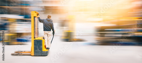 Obraz Forklift Worker In Motion AT Work in Warehouse  | Long Exposure Blurred - fototapety do salonu