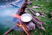 Cooking Dinner On Wood. Cooking Using Wood Is An Survival Skill Needed When Going To The Wilderness Or Outdoor Activity.
