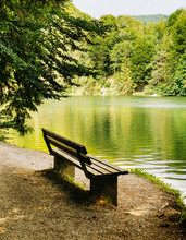 Bench Near The Picturesque Mountain Lake