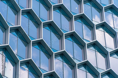 office-buildings-structure-of-hexagon-windows-in-futuristic-technology-network-connection-concept-blue-glass-modern-architecture-facade-design-with-reflection-of-sky-in-urban-city-downtown