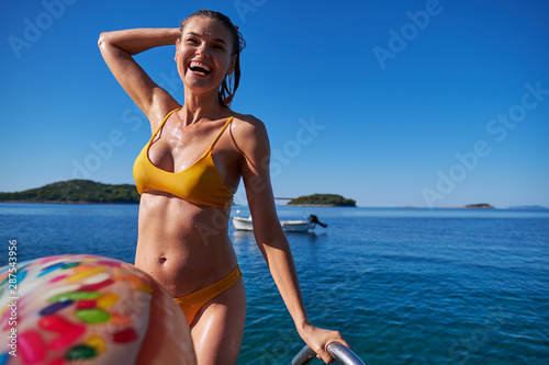 Foto auf Gartenposter Individuell Portrait of beautiful woman on the sea Summer day background. Young woman outdoor