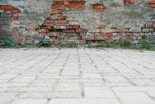 Old Derelict Wall And Pavement Background With Copy Space