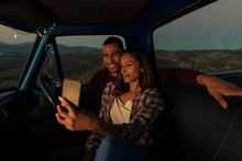 Young Couple On A Road Trip Ta...