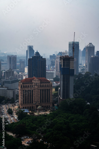 Aerial drone view of Kuala Lumpur city skyline during cloudy day, Malaysia Wallpaper Mural