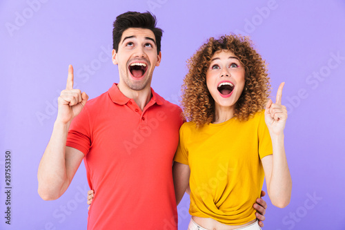 Portrait of amazed caucasian people man and woman in basic clothing smiling and Canvas Print